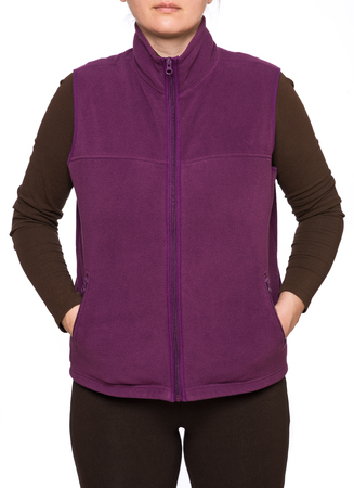 Young woman wearing purple fleece vest isolated on white background 免版税图像