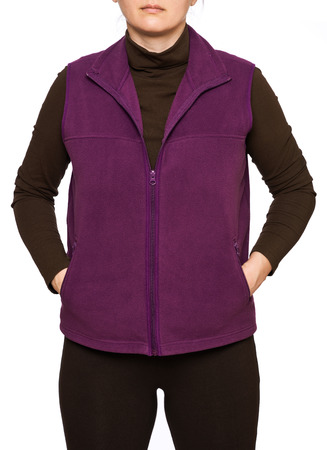 Young woman wearing purple fleece vest isolated on white background 스톡 콘텐츠