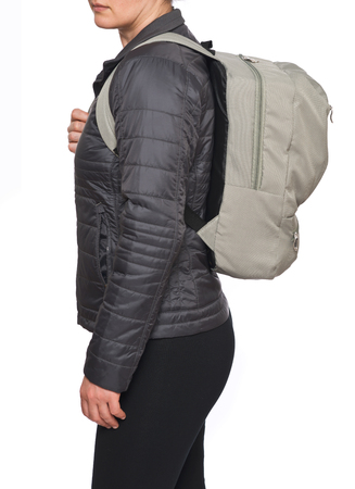 Young Caucasian Woman wearing sage grey backpack isolated on white background 免版税图像