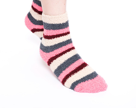 Multicolor women's fuzzy ankle socks with stripes isolated on white background