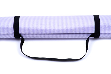 Lavender rolled yoga mat with black handy carrying strap isolated on white background Reklamní fotografie - 91859844
