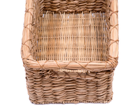 Vintage natural rectangular seagrass handmade basket isolated on white background