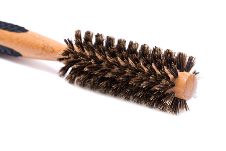 Round natural bamboo hairbrush with wild boar bristles isolated on white background Stock Photo