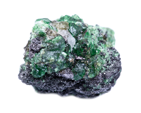 Partially crystallized rough Tsavorite from Tanzania isolated on white background Stock Photo