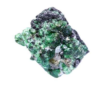 Partially crystallized rough Tsavorite from Tanzania isolated on white background Foto de archivo