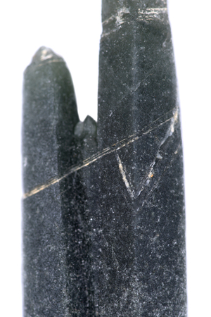 Blue quartz point with tourmaline inclusions from Brazil isolated on white background