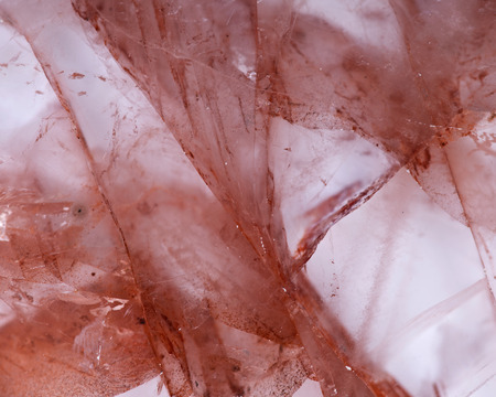 Polished quartz stone with red hematite inclusions from Madagascar