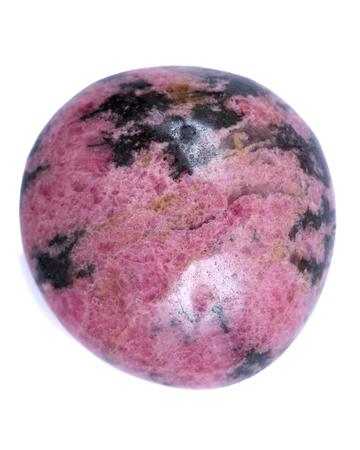 Rhodonite polished palm stone from Madagascar, isolated on white background