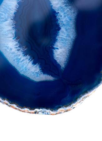 Polished multicolor agate slice isolated on white background