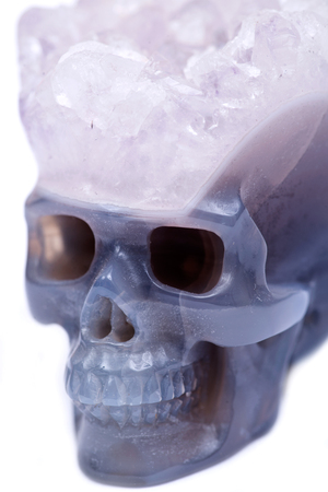 Blue lace agate druse carved crystal skull, isolated on white background