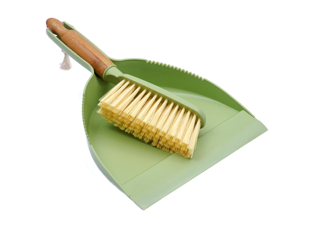 Green dustpan and natural bamboo broom set isolated on white background