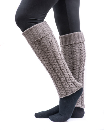 Young woman wearing cable knit leg warmers taupe color isolated on white background Stock Photo