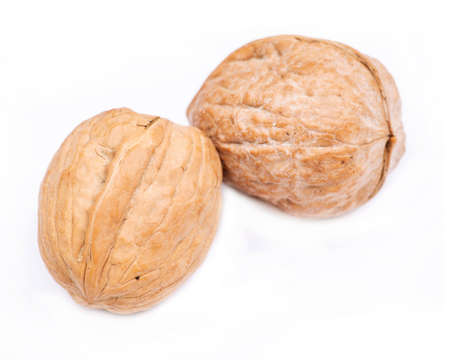 Brown raw organic walnut isolated on white background