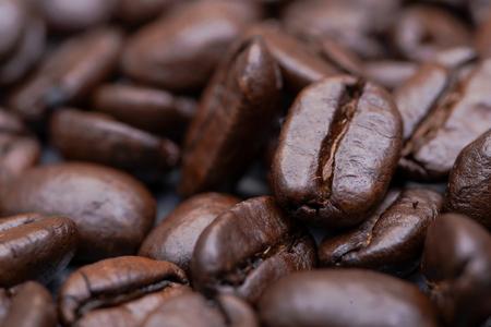 Macro shot of whole bean organic smooth medium dark roast coffee from Sumatra on natural stone background Фото со стока