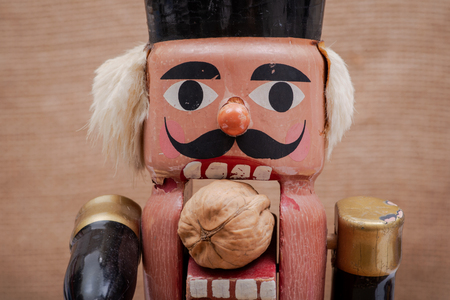 Colorful traditional antique vintage decorative figurine wooden soldier nutcracker. Stock Photo