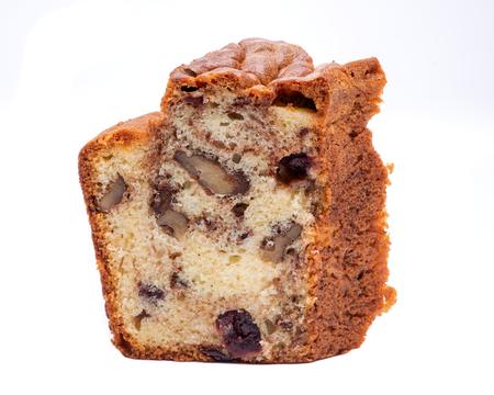 Homemade cranberry and walnut cake isolated on white background Stock Photo