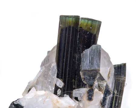 Gem quality Green Tourmaline crystal on matrix with a nice clear topaz from Pakistan isolated on white background. Stock Photo