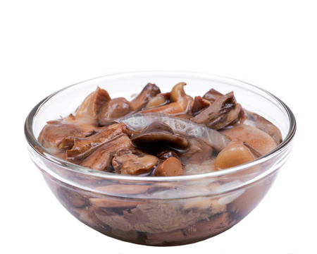 Organic boletus luteus marinated mushrooms in clear glass bowl