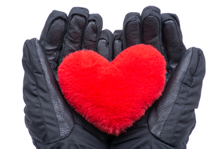 Hands in black gloves holding Red fluffy plush Heart isolated on white background.