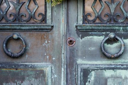 Two Knocker Rings on Old Vintage rustic Door. Antique Door Knobs.