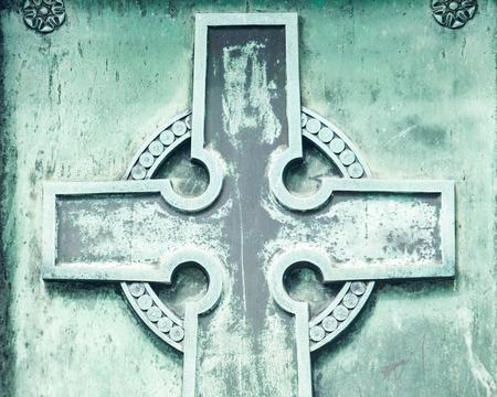 Christian symbol. Old Vintage Cross at Catholic Cemetery.