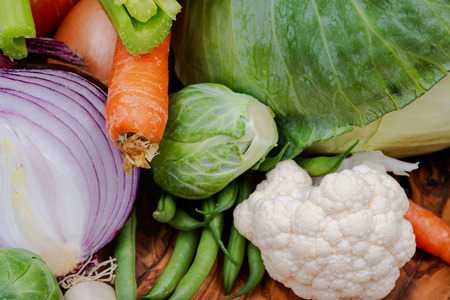 A variety of fresh raw Organic Vegetables including Cabbage, Garlic, Onion, Carrots, Cauliflowers.