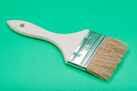 Flat Chip Painting Brush isolated on green background.