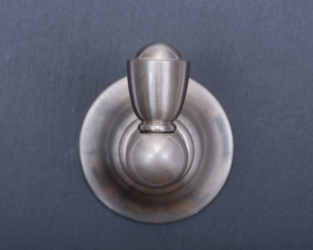 Brushed Nickel Metal Wall  Hook with Damage-Free Hanging isolated on gray background.