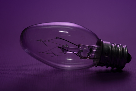 Clear Incandescent Night Light Bulbs with candelabra base on purple background. 스톡 콘텐츠