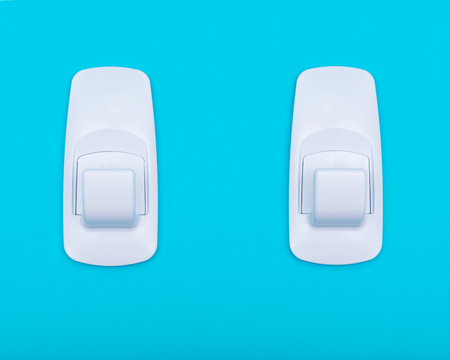 White Plastic Jumbo Utility Wall Hook with Damage-Free Hanging isolated on blue background.