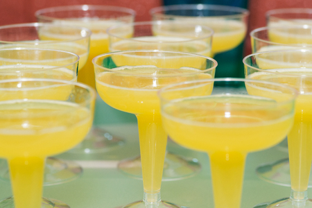 Cold Refreshing Lemon Drink in fancy margarita glasses at a party table. Stock fotó