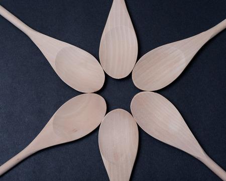 Handmade Wood Cook Spoons on dark background. Wood cooking utensils. Imagens