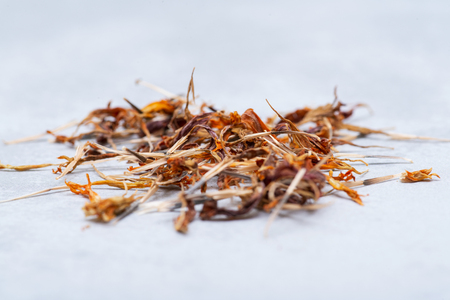 Pile of Marigold Dry Seeds (Mexican marigold, Aztec marigold, African marigold) on gray background. Tagetes erecta. Daisy family.