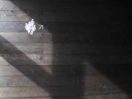 the white people symbol and arrow in the wood wall