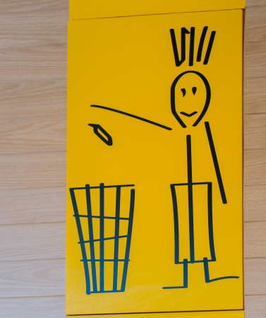 trash bin sign on the wall, yellow background