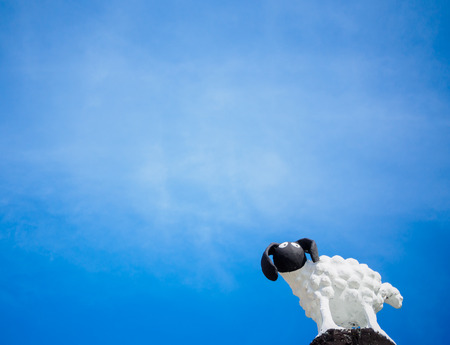 little sheep statue in blue sky background Stock Photo