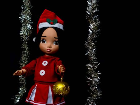 cele: santy doll , a doll wear santa dress