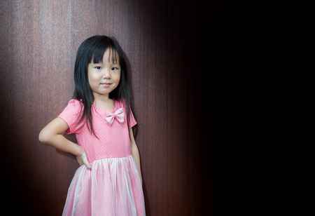 akimbo: Portrait of Asian happy little girl , akimbo