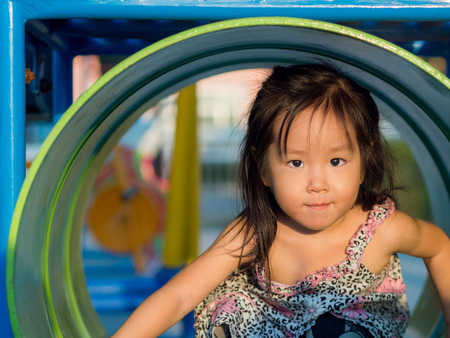 asian family fun: Happy kid, asian baby child playing on playground Stock Photo