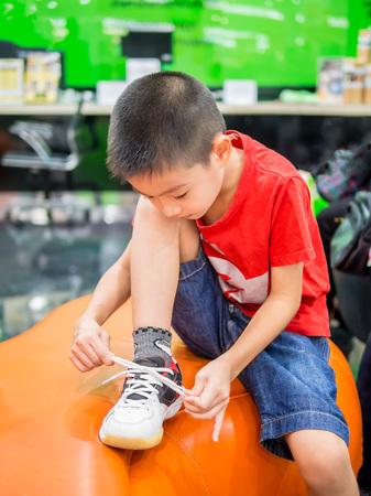 shoelace: Young boy tying shoelace