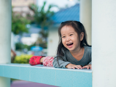 peekaboo: Adorable little girl playing peekaboo, asian child