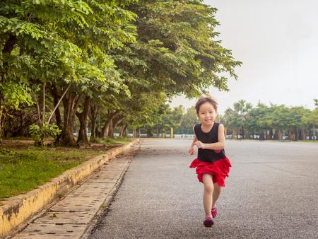 Happy kid, asian baby child running in the garden