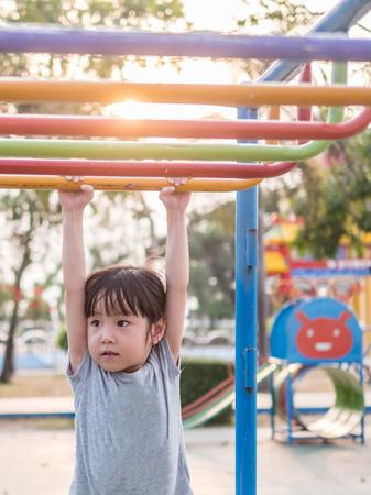 Happy kid, asian baby child playing on playground Imagens