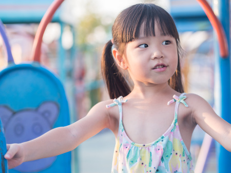 Happy kid, asian baby child playing on playground Stock Photo