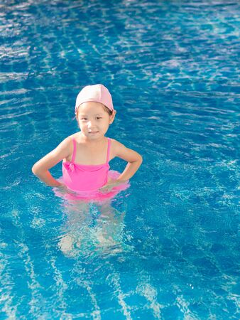 akimbo: Asian girl is playing in the pool, akimbo