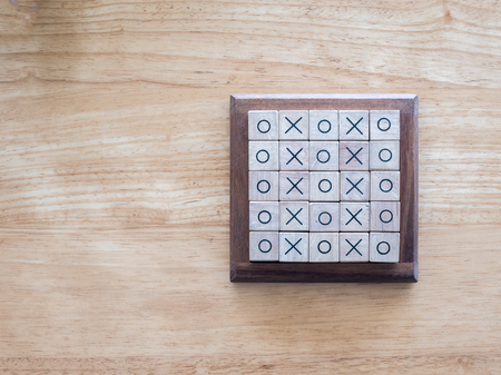 wooden block: OX game , made by wooden block, on wood background