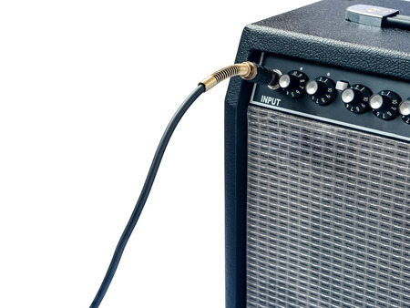 amp: guitar amplifier with jack cable isolated on white background