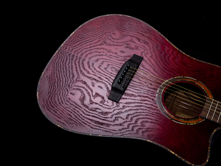 Acoustic  Guitar, Red body, close up on black background