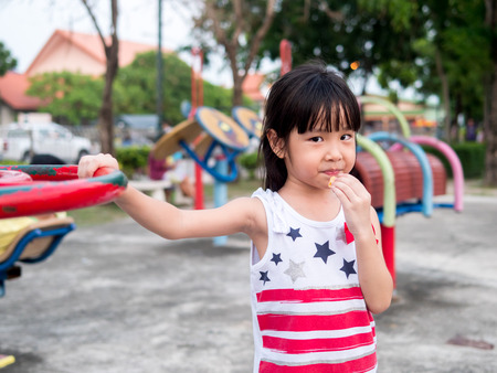 Happy asian baby child playing on playground