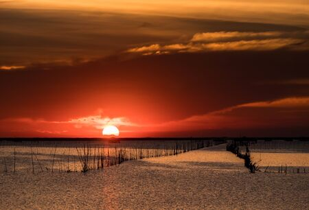 Beautiful sunset above sea in thailand. Silhouette of fish farms at sunset.